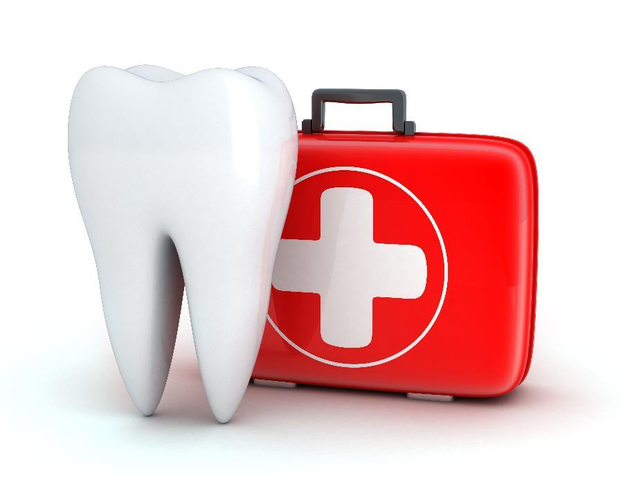Enlarged tooth next to first aid kit